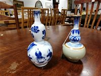 Lot 23-Chinese blue and white double gourd-shape vase, and a Chinese blue, white and celadon bottle vase