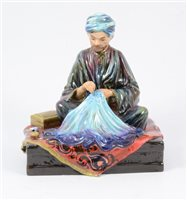 Lot 32-Reginald Johnson, a hand-painted pottery figure, Embroiderer of Kashmir.