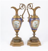 Lot 90-A pair of French Sevres style garniture ewers (2)