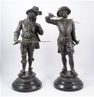 Lot 92-A pair of patinated spelter figures, of Cavaliers, raised on ebonised socles (2)