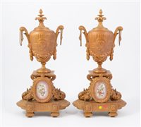 Lot 94-Two gilt metal garnitures inset with porcelain plaques