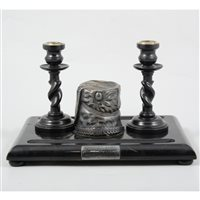 "Lot 70-A Victorian ebonised ink stand with silver busby inkwell by S Smith & Son, engraved plaque to front ""From Major George Luck to Sergeant Major Henry Merrick"""
