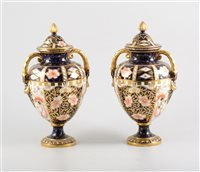 Lot 6-Royal Crown Derby pair of ovoid vases, twin handles and covers.