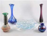 Lot 17-Orrefors glass dish, ribbon moulded form, clear glass, diameter 33cm; blue tinted moulded glass bud vase; another tinted glass bud vase.