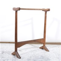 Lot 508-An Arts and Crafts oak towel rail by Gordon Russell, circa 1925.