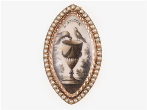 Lot 178-A 19th century rose metal mounted Memento Mori navette shaped brooch