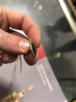 Lot 178-A 19th century rose metal mounted Memento Mori navette shaped brooch