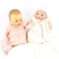 Lot 85-Armand Marseille bisque head baby doll 351/1K stamped head, and another AM doll.