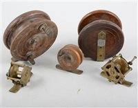 Lot 82-Mahogany and brass vintage fishing reel, 10.5cm, and four other vintage fishing reels, (5).