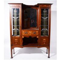Lot 516-An English Art Nouveau mahogany and inlaid display cabinet.