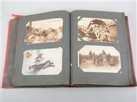 Lot 102-Postcard album containing approximately 90 First World War cards and later.