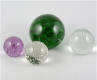 Lot 37-Five glass bubble paperweights, with controlled bubble design, various sizes. (5)
