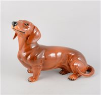 Lot 52-A Beswick fireside dachshund figure, 35cm long from nose to tail, 27cm tall.