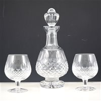 Lot 43-Four Waterford Crystal brandy balloon glasses, Colleen pattern, and a matching crystal decanter.