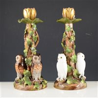 Lot 16-Pair of 19th Century German porcelain candlesticks, with owl design bases.