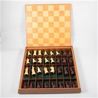 Lot 86-A modern resin chess set in the Chinese Imperial style in fitted wooden case with integral board