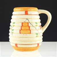 "Lot 4-Clarice Cliff ribbed jug, ""Raffia Indiana"" pattern circa 1935, shape 736, 18cm."
