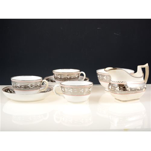 Lot 21-Staffordshire silver lustred part tea service, circa 1820, silver resist banding with floral motifs.