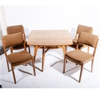Lot 507-An English Arts and Crafts style oak dining table and chairs, circa 1950