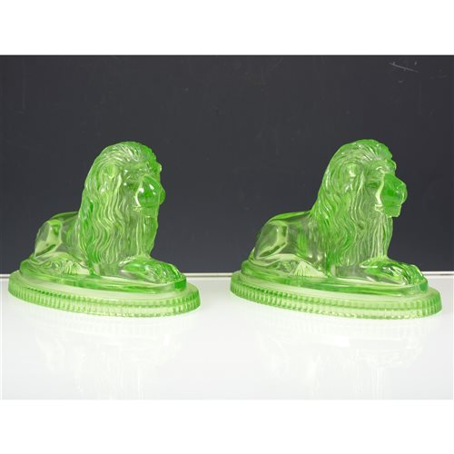 Lot 31-Pair of John Derbyshire green moulded glass lions, signed to base and dated 3rd July 1874.