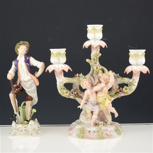 Lot 24-A Sitzendorf three branch porcelain candelabra 23.5cm, and a Continental porcelain figure of a gardener, 20.5cm, (2).