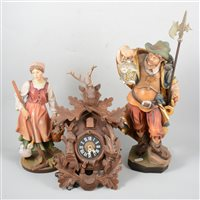 Lot 110-Cuckoo clock and two wooden figures.