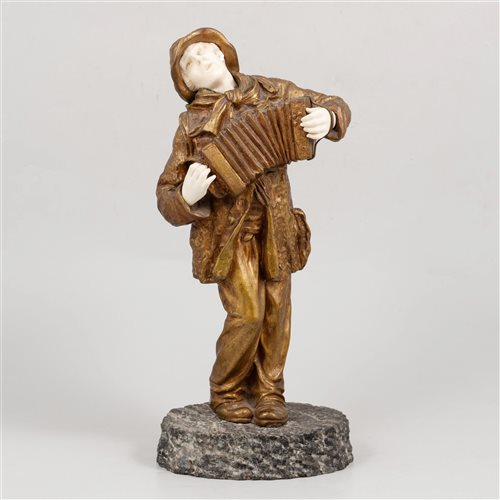 Lot 592 - A gilt bronze and carved ivory sculpture of an accordion player, by Demétre Chiparus.