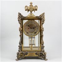 Lot 82-French style American four glass mantel clock, cast urn finial, silvered dial with visible escapement, movement striking on a gong signed Ansonia, New York, 40cm.