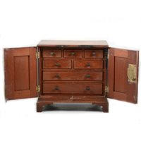 Lot 83-A mahogany two door table cabinet with fitted interior