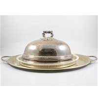 Lot 116-Victorian electroplated oval meat dish cover, cast handle, 36cm, an oval plated tea tray, a modern plated gallery tray, a salver and a stand, (5).