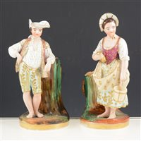 Lot 2-Pair of French porcelain figural spill vases, the standing figures designed as flasks, 24cm.