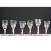 Image for Collection of six wine glasses, rounded funnel bowl, ruby and opaque twist stems.