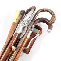 Lot 73-Shooting stick, Mills Munitions Ltd, Birmingham, three other shooting sticks, walking sticks, a crop, etc.