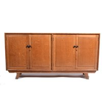 Lot 506-An Arts and Crafts style oak sideboard, circa 1950