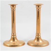 Lot 76-A pair of 19th Century gunmetal candlesticks, 23cm high, plain oval bases and cylindrical stem. (2)