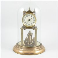 Lot 93-A brass anniversary clock, with white enamelled dial with Arabic numerals.
