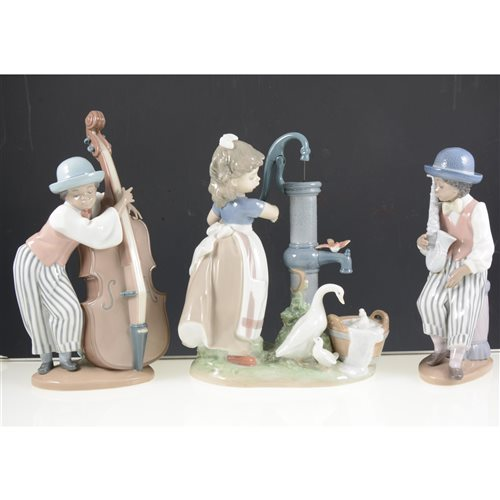 Lot 42-Lladro group, A Big Sister, No. 5735, width 22cm, a Lladro group Girl at a pump, three Lladro band figures, a Nao figure, (6).