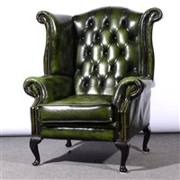 491 - Traditional style close studded green leather wing-back easy chair, on cabriole legs, width 93cm.