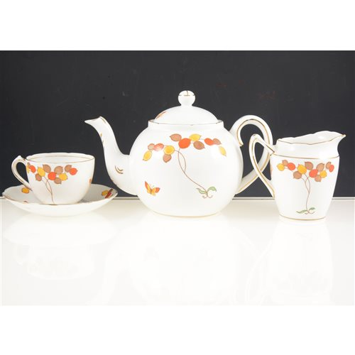 Lot 41-Diamond China Limited teaset, decorated with coloured leaves.