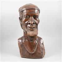 Lot 119-African carved hardwood bust of a tribesman, 44cm.