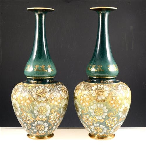 Lot 20-A pair of Doulton silicon style bottle neck vases on a green ground with gilded highlights, 42cm. (2)