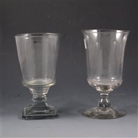 Lot 16-George III glass goblet, bell-shape bowl; and a Regency goblet, bucket bowl (2).