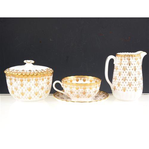 Lot 19-Spode bone china half tea set, fleur de lys gold pattern.