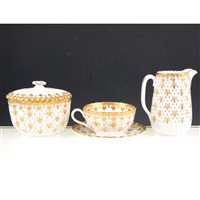 Lot 19-Spode bone china half tea set, fleur de lys gold pattern.