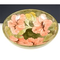 Lot 3-Moorcroft circular bowl, Hibiscus design with a Royal Warrant label, diameter 26cm.