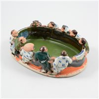 Lot 52A-A Sumida Gawa stoneware figural bowl, the rim with ten figures peering into the interior.
