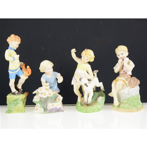 Lot 23-A collection of Royal Worcester Months of the Year figurines, comprising January, February, March, April, May, June, July, October and December, 20cm and smaller, (9)