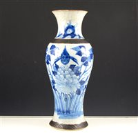 Lot 30-A Japanese crackle glazed blue and white vase, baluster shape, painted with bird and flowers, 30cm.