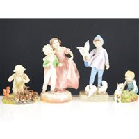 Lot 18-A collection of Royal Worcester figurines, comprising 'Peter Pan' 3011, 'Pansy' 2930, 'Two Babies' 3450, 'Fantails' 3760, 'Young Farmer' 3433, 'Mischief' 2914 (9)