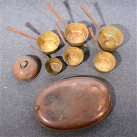 Lot 107-Copper foot warmer, width 61cm, a collection of brass saucepans and other metalware.